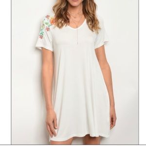 Off-white floral embroidery jersey tunic dress.